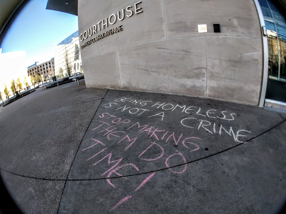 Chalk writing outside the courthouse. (Kevin J. Beaty/Denverite)