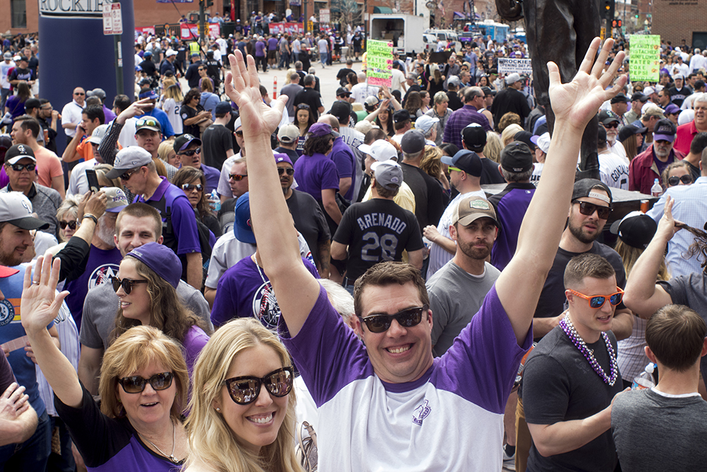 Ike Mundell raises his hands in apparent jubilation. Coors Field opening day, April 7, 2017. (Kevin J. Beaty/Denverite)  rockies; ballpark; coors field; sports; baseball; opening day; denver; colorado; denverite; kevinjbeaty;