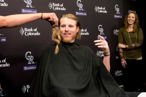 The Colorado Rockies' Jon Gray, accompanied by his wife Jacklyn, lops off 8 inches of hair for Locks of Love, April 11, 2017. (Kevin J. Beaty/Denverite)  colorado rockies; baseball; jon gray; locks of love; barber; denverite; denver; kevinjbeaty