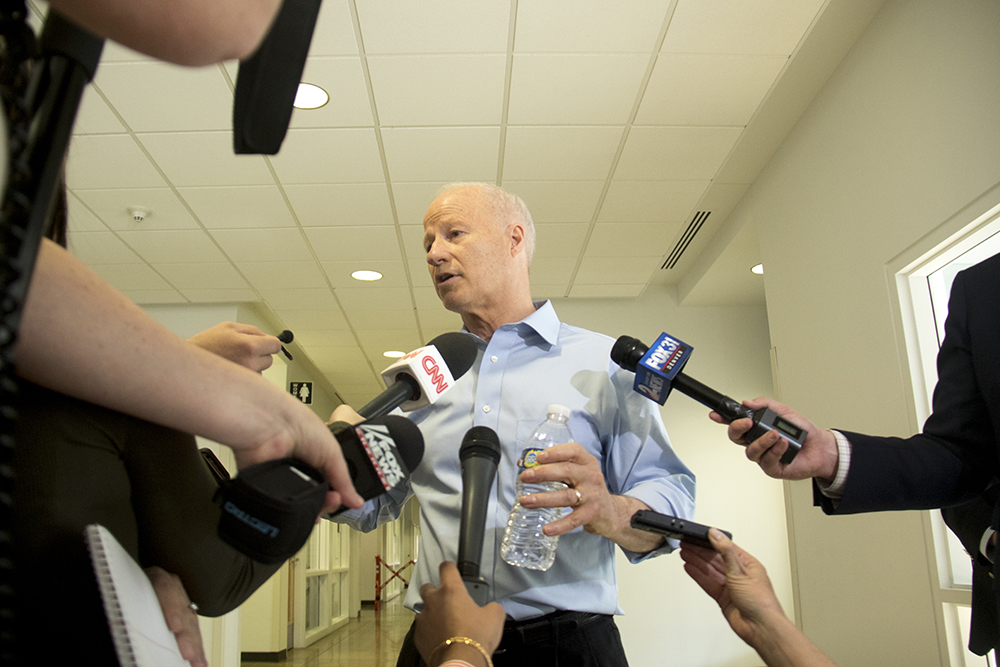 U.S. Rep. Mike Coffman speaks to press before his first town hall meeting of the Trump administration, April 12, 2017. (Kevin J. Beaty/Denverite)  mike coffman; aurora; town hall meeting; copolitics; kevinjbeaty; denverite; colorado;