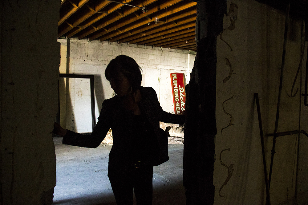 Carolyn Corogin gives a tour of her developing Englewood property at 3853-3855 S. Broadway, April 14, 2017. (Kevin J. Beaty/Denverite)  development; englewood; construction; commercial real estate; south broadway; kevinjbeaty; denver; colorado; denverite;