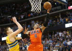 Russell Westbrook broke Oscar Robertson's single-season triple-double record Sunday as the Nuggets' playoff hopes oficially ended. (Chris Humphreys/USA Today Sports)
