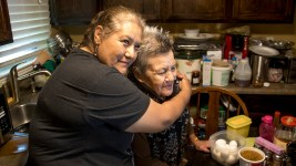 Harvey Park resident Antonia Aguirre Muñoz (right) in her kitchen with Re:Vision promotora Leticia Manquera, May 26, 2017. (Kevin J. Beaty/Denverite)  food desert; agriculture; gardening; re:vision; revision; harvey park; denver; denverite; colorado; kevinjbeaty;