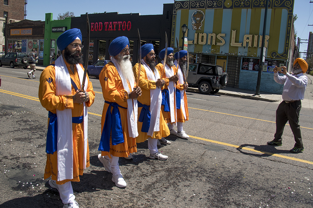 "Men ceremoniously dressed as the Panj Pyare, the ""Five Beloved Ones,"" or the first Sikhs walk over Colfax Avenue. The second-annual Sikh parade, May 28, 2017. (Kevin J. Beaty/Denverite)  sikh; colorado singh sabha; east high school; denver; colorado; parade; kevinjbeaty; denverite;"