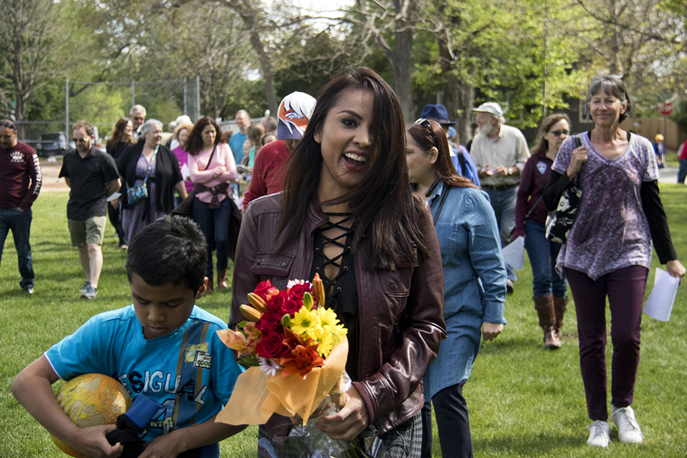 Ingrid Encalada Latorre leads a procession of supporters after leaving sanctuary for the first time in nearly 6 months, May 20, 2017. (Kevin J. Beaty/Denverite)  immigration; ingrid encalada latorre; deportation; undocumented; sanctuary; kevinjbeaty; denver; denverite; colorado;