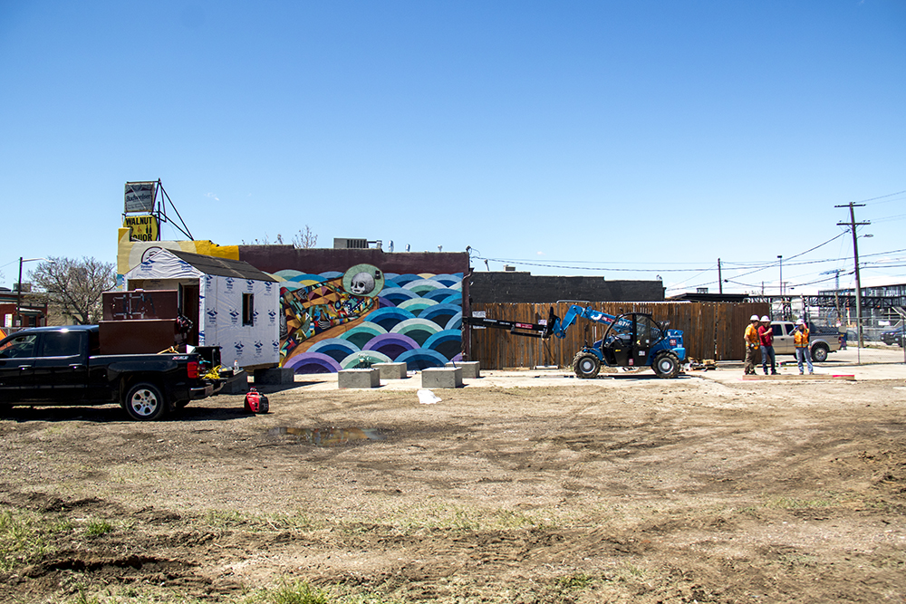 The future site of 11 tiny homes at 38th and Walnut streets. Construction on the Beloved Community Village begins at Walnut and 38th streets, May 20, 2017. (Kevin J. Beaty/Denverite)  homeless; right to rest; tiny home village; rino; five points; denver; denverite; colorado; kevinjbeaty;