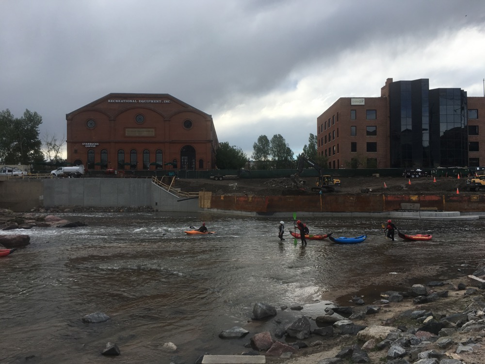 Intrepid kayakers in Confluence Park on the South Platte River on a gloomy afternoon. (Andrew Kenney/Denverite)