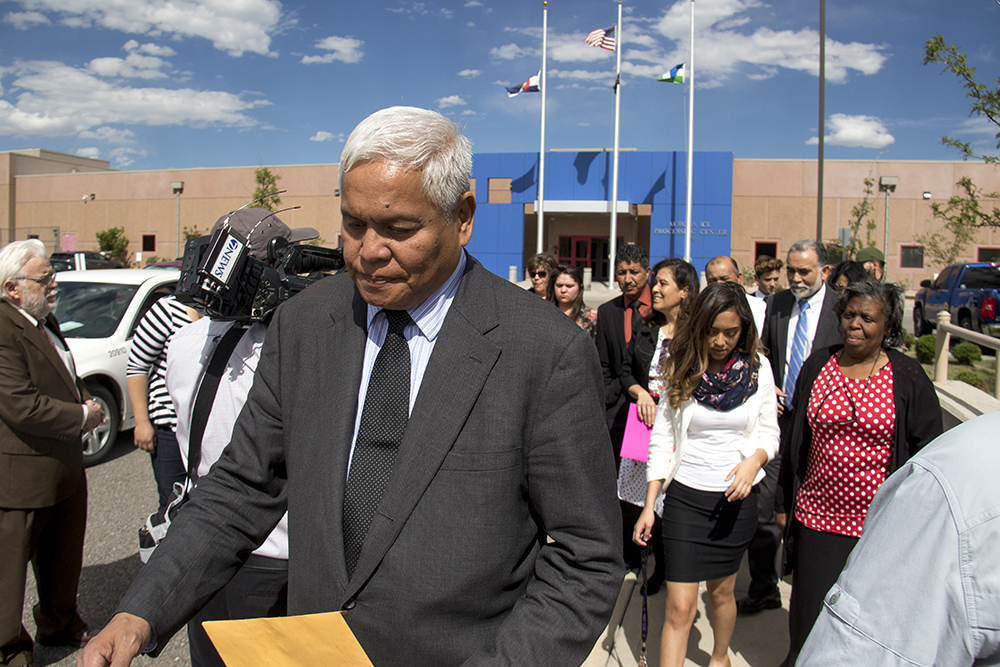 Isidro Quintana's pastor Joel Barnedo walks away from the GEO private detention facility after a guard ordered the group off the property, May 15, 2017. (Kevin J. Beaty/Denverite)  isidro quintana; aurora; GEO; immigration; deportation; kevinjbeaty; denverite; colorado