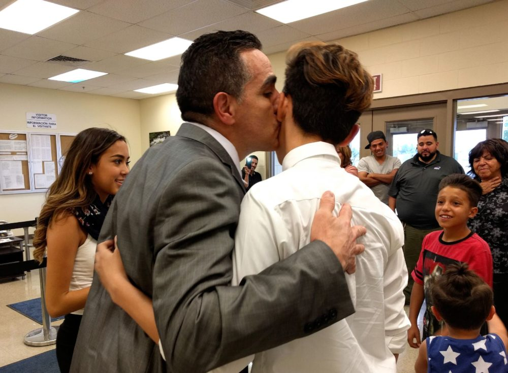 Isidro Quintana embraces his son Angel after being released from immigration detention. (Kevin J. Beaty/Denverite)
