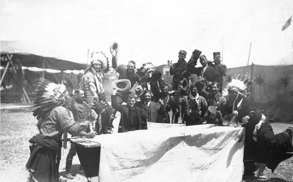 Two Native American men (no further information provided) play ping-pong in front of assorted other men including cavalrymen and Russian Cossacks in 1901, according to a library connection. The match was related to Buffalo Bill's Wild West Show. (Western History & Genealogy Dept./Denver Public Library)