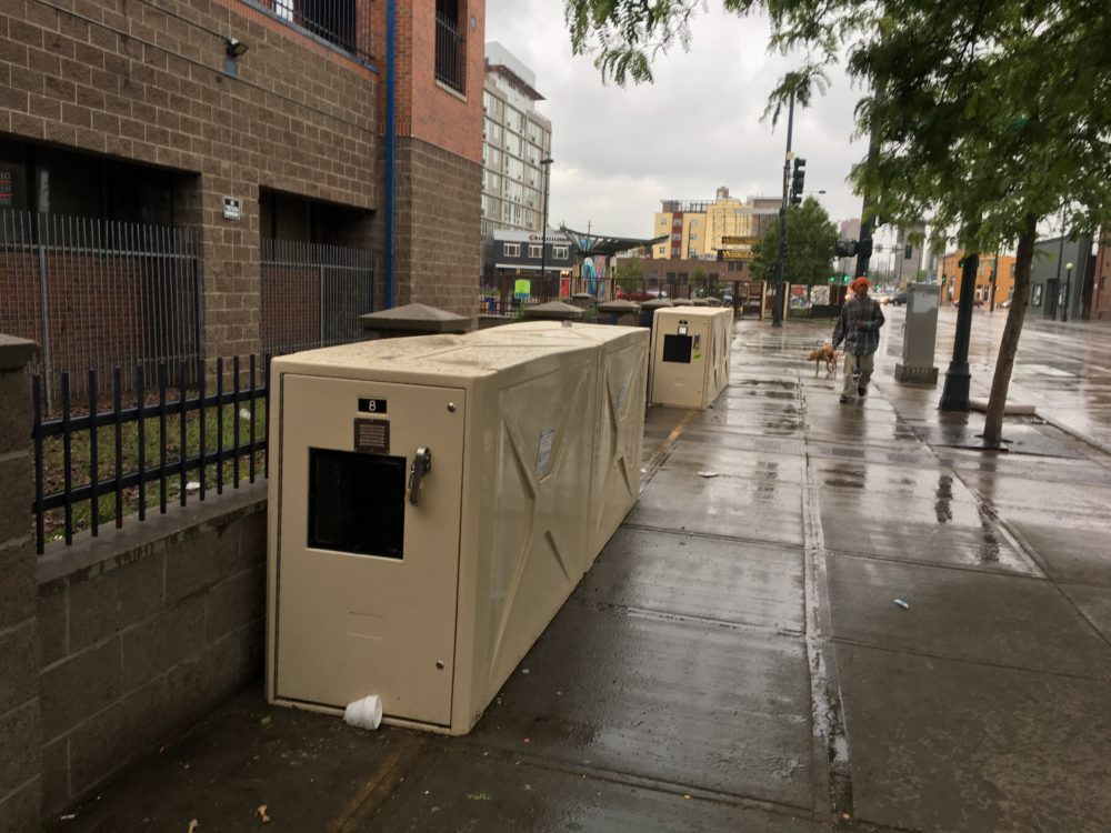 Sidewalk storage units on Lawrence Street near the Denver Rescue Mission and Samaritan House. (Andrew Kenney/Denverite)