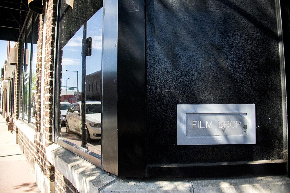 An old film drop slot into John Fielder's Colorado on Santa Fe Drive. (Kevin J. Beaty/Denverite)  art district on santa fe; gallery; fine art; kevinjbeaty; denver; colorado; denverite; lincoln park;
