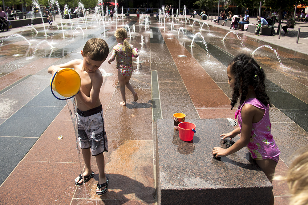 Athena and Wyatt play in the Union Station fountain.  (Kevin J. Beaty / Denverite)