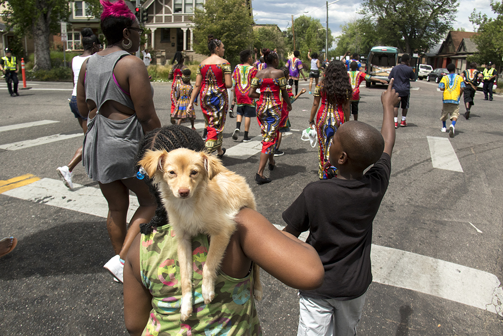A dog named bella rides on her girl, Mikell's, shoulders. The Juneteenth parade in Five Points, June 17, 2017. (Kevin J. Beaty/Denverite)  juneteenth; five points; black history; kevinjbeaty; denver; colorado; denverite; street fair; festival; welton street;