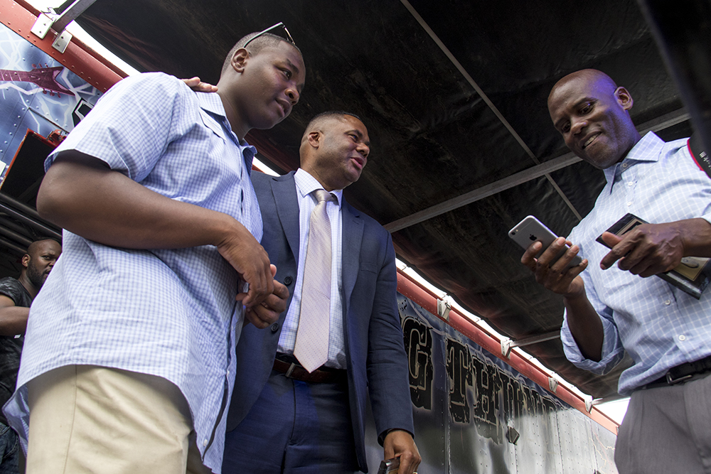 Candidate for Denver School Board Tay Anderson speaks with fellow Manual High School alumni, social justice attorney Ryan Haygood. Juneteenth in Five Points, June 17, 2017. (Kevin J. Beaty/Denverite)  juneteenth; five points; black history; kevinjbeaty; denver; colorado; denverite; street fair; festival; welton street;