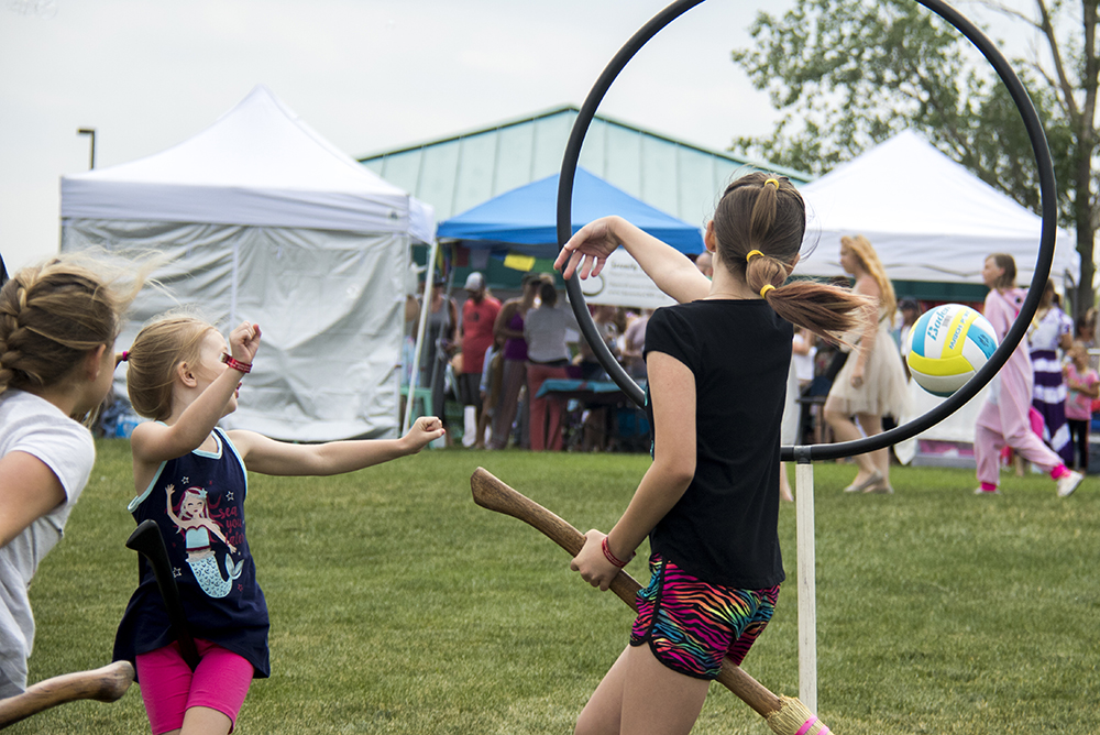Team Gryffindor scores a point on the Quidditch pitch. The first-annual Unicorn Festival in Clement Park, Littleton. (Kevin J. Beaty/Denverite)  colorado; kevinjbeaty; unicorn festival; denverite; littleton; whimsy; summer;