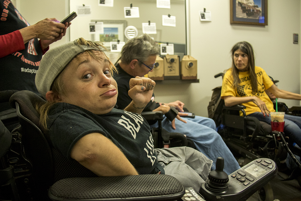 Kalyn Heffernan poses for a portrait. A sit-in at Senator Cory Gardner's office opposing a Republican healthcare plan, June 28, 2017. (Kevin J. Beaty/Denverite)  denverite; protest; cory gardner; sit in; civil disobedience; healthcare; medicaid; kevinjbeaty; denver; colorado;