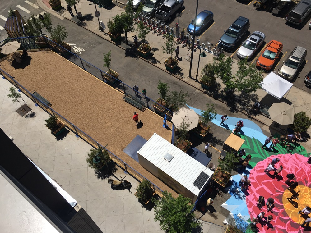 A dog park is shown at left in this view of Square on 21st. (Andrew Kenney/Denverite)