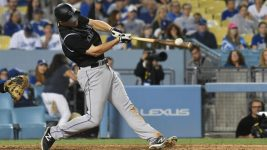Colorado Rockies left fielder Gerardo Parra (8) hits a single against the Los Angeles Dodgers in the eighth inning at Dodger Stadium. (Richard Mackson-USA TODAY Sports)