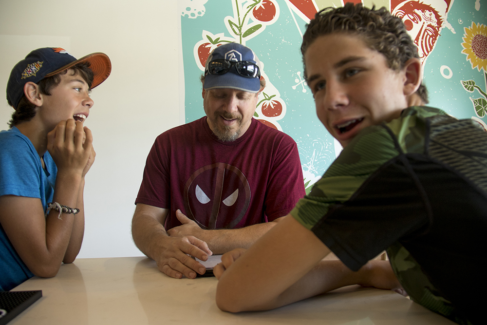 Sazza Restaurant owner Jeff Rogoff and his sons Sam (left) and Izaak inside their spot at the Stanley Marketplace. (Kevin J. Beaty/Denverite)  aurora; stanley marketplace; denverite; colorado; kevinjbeaty;