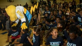 Rocky the Mountain Lion, the Nuggets mascot, interacts with stoked kids. Paul Millsap is officially introduced as a new Nuggets player at the Montbello Recreation Center, July 13, 2017. (Kevin J. Beaty/Denverite)  denver; colorado nuggets; basketball; sports; montbello recreation center; denverite; kevinjbeaty;