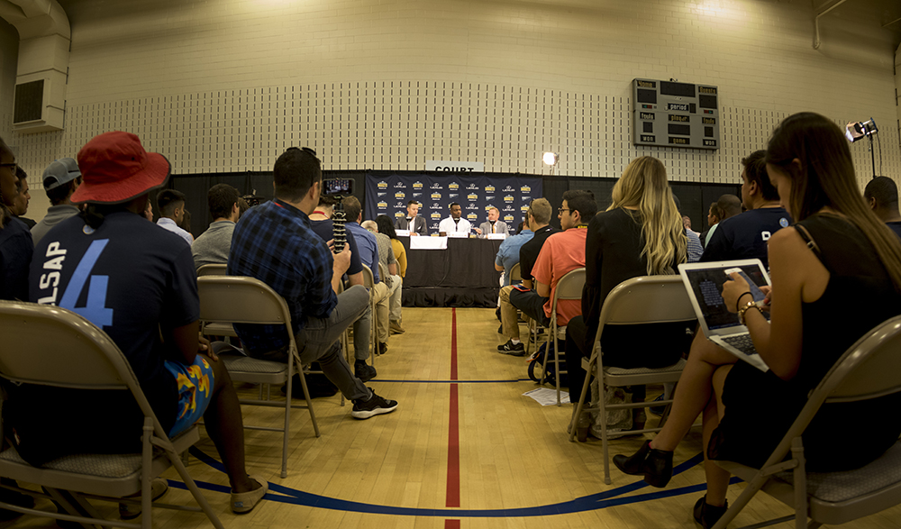 Paul Millsap speaks to press with Tim Connelly, president of basketball operations, to his left and Josh Kroenke, team president and governor, to his right. Montbello Recreation Center, July 13, 2017. (Kevin J. Beaty/Denverite)  denver; colorado nuggets; basketball; sports; montbello recreation center; denverite; kevinjbeaty;