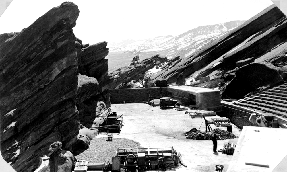 A side view of the stage and seating area at Red Rocks amphitheater under construction, Red Rocks Park, Morrison, Jefferson County, Colorado. (Denver Public Library/Western History Collection/X-20502)  red rocks; civilian conservation corps; archive; denver; colorado; kevinjbeaty;