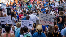 A protest against U.S. Secretary of Education Betsy DeVos, who is scheduled to speak at an American Legislative Exchange Council this week. July 19, 2017. (Kevin J. Beaty/Denverite)  denver; colorado; denverite; kevinjbeaty; betsy devos; copolitics; protest; capitol; education;
