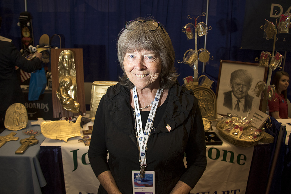 Mary Catherine Unrein and her booth at the Western Conservative Summit, July 21, 2017. (Kevin J. Beaty/Denverite)  western conservative summit; wcs; protest; cory gardner; healthcare; adapt; medicaid; denver; denverite; kevinjbeaty;