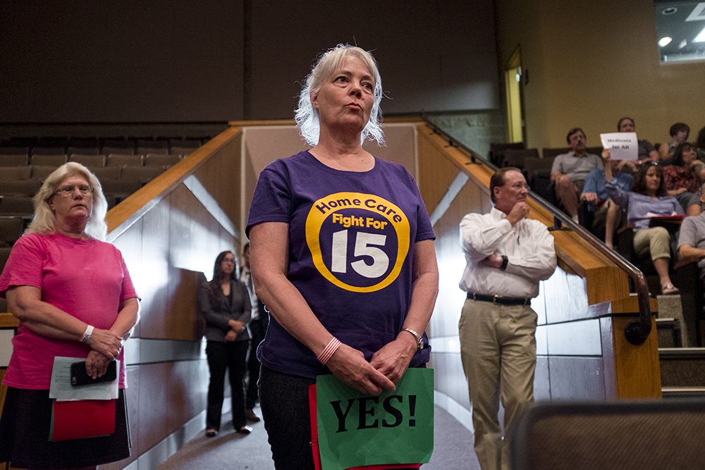 Casey DiGaetano listens as Mike Coffman responds to her question about insurance companies' monetary influence in politics. She said she did not feel that Coffman answered her question. Aug. 1, 2017. (Kevin J. Beaty/Denverite)  mike coffman; copolitics; denver; denverite; colorado; politics;