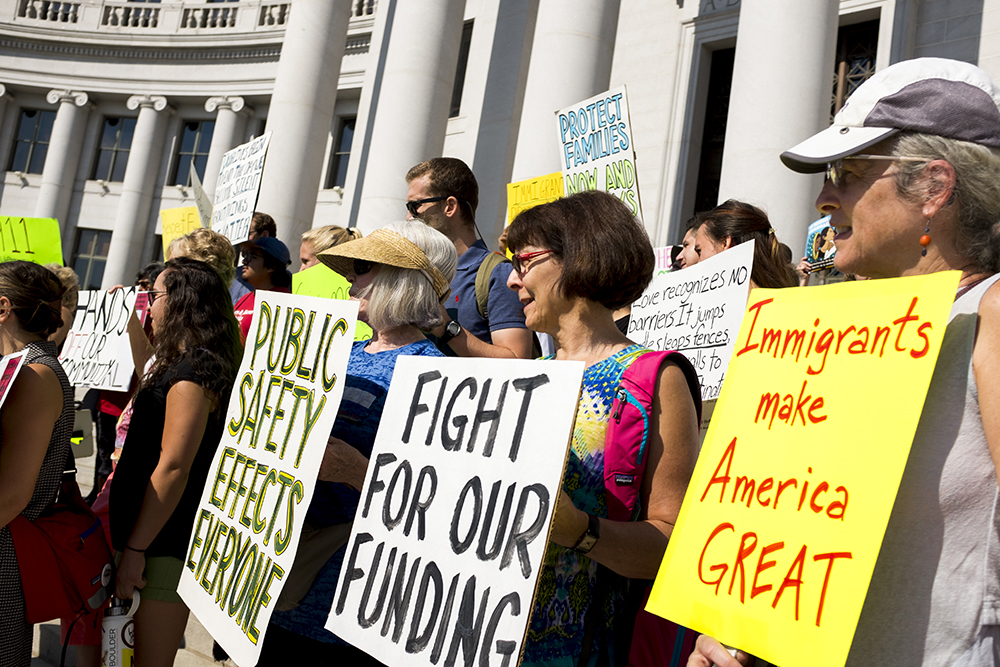 A rally on the steps of the City and Couny Building before a Denver City Council hearing on immigration policy begins, Aug. 2, 2017. (Kevin J. Beaty/Denverite)  immigration; undocumented; city and council building; denver; colorado; denverite; city council; kevinjbeaty;