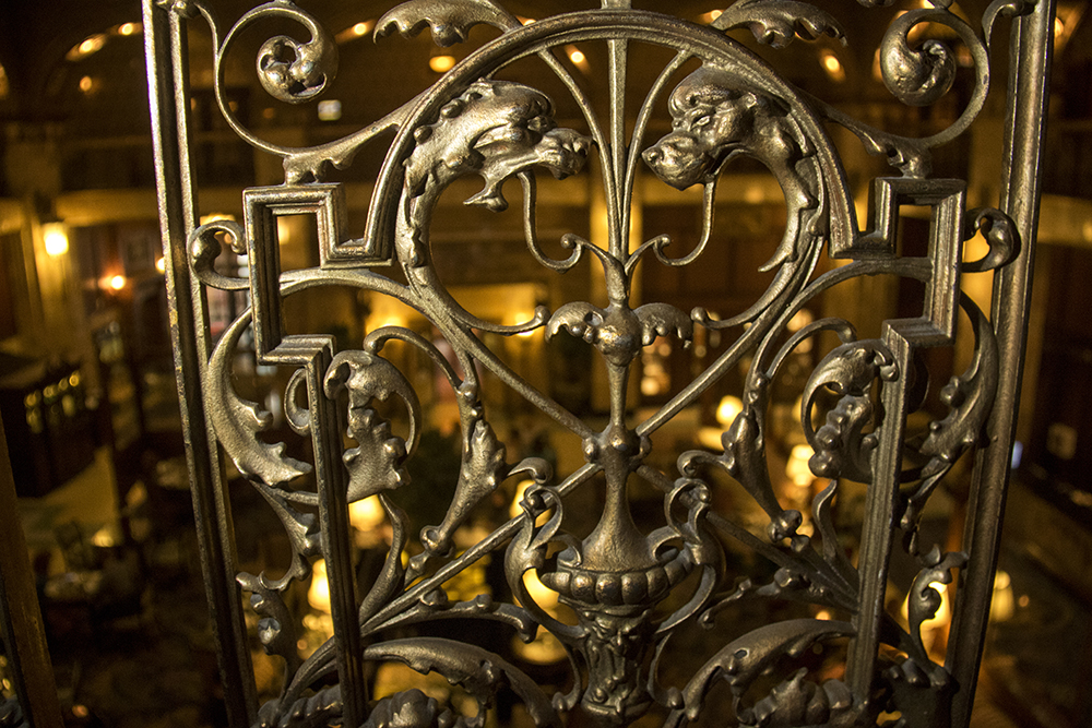 Griffins adorn grating along the open halls inside the Brown Palace Hotel, Aug. 3, 2017. (Kevin J. Beaty/Denverite)  brown palace hotel; denver; colorado; denverite; kevinjbeaty;
