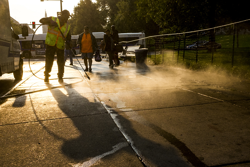 A Colfax sidewalk gets a (probably much needed) hose down, Aug. 4, 2017. (Kevin J. Beaty/Denverite)  capitol hill; colfax; denver; colorado; denverite; kevinjbeaty;