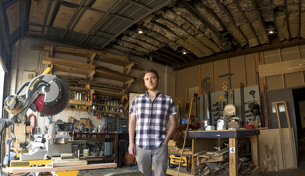 ReCreative co-founder Chris Scott poses for a photo in the space's woodshop, Aug. 4, 2017. (Kevin J. Beaty/Denverite)  art district on santa fe; recreative; diy; gallery;