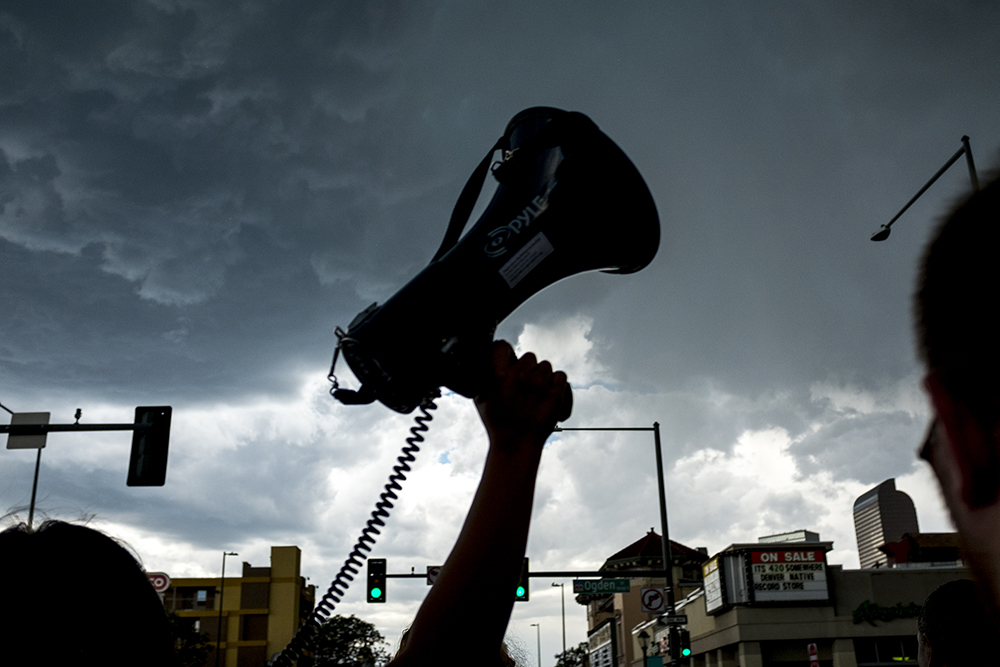 Storm clouds roll in over the march. A rally in response to white supremacist protests in Charlottesville, VA, Aug. 13, 2017. (Kevin J. Beaty/Denverite)  protest; charlottesville; rally; denver; colorado; kevinjbeaty; denverite; colfax
