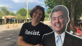 "Kristen Seidel of Indivisible Denver couldn't bring Cardboard Cutout Cory Gardner inside the town hall because he violated the ""no signs bigger than a sheet of paper"" rule. Aug 15, 2017. (Erica Meltzer/Denverite)"