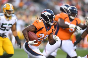 Denver Broncos running back Jamaal Charles carries the ball in the first quarter of a preseason game against the Denver Broncos at Sports Authority Field. (Ron Chenoy/USA Today Sports)