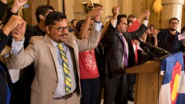 Colorado House Representative Dan Pabon leads a chain of hand holding with DREAMers during a press conference on the possible repeal of Deferred Action for Childhood Arrivals, known as DACA, Sept. 1, 2017. (Kevin J. Beaty/Denverite)  denver; colorado; undocumented; daca; dream act; immigration; kevinjbeaty; denverite;