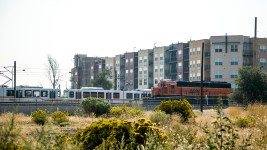"The future ""Santa Fe residential district"" along South Santa Fe Drive and a train. (Kevin J. Beaty/Denverite)"