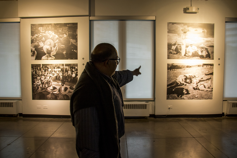 """Alfonso Morales, co-curator of """"Under the Mexican Sky,"""" an exhibit on the work of cinematographer Gabriel Figueroa at the McNichols Building and part of the Biennial of the Americas. Sept. 12, 2017. (Kevin J. Beaty/Denverite)  mcnichols building; art; biennial of the americas; denver; colorado; denverite; kevinjbeaty;"""