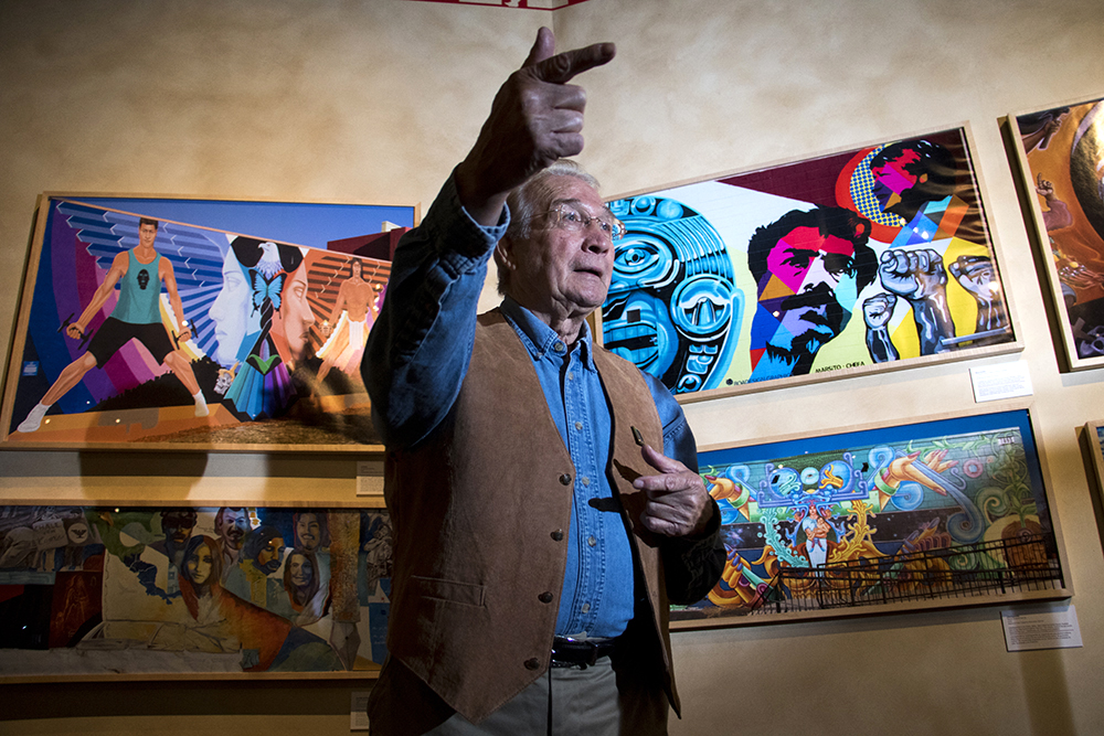 """Ricardo Lafore stands in a temporary art installation of Chicano art as """"El Movimiento,"""" or """"The Movement,"""" as is installed nearby, Sept. 12, 2017. (Kevin J. Beaty/Denverite)  denver; colorado; denverite; kevinjbeaty; history colorado; chicano;"""