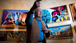 "Ricardo Lafore stands in a temporary art installation of Chicano art as ""El Movimiento,"" or ""The Movement,"" as is installed nearby, Sept. 12, 2017. (Kevin J. Beaty/Denverite)  denver; colorado; denverite; kevinjbeaty; history colorado; chicano;"
