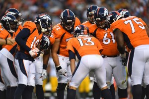 Trevor Siemian and the Broncos in the huddle. (Ron Chenoy/USA Today Sports)