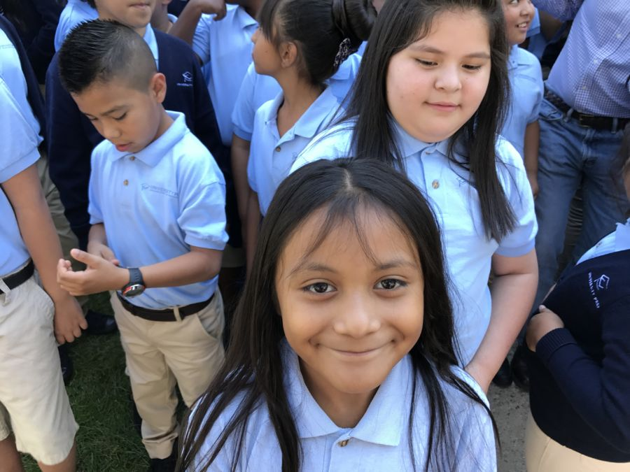 A student at University Prep Steele Street in Denver smiles at a celebration of the school's test scores in August 2017. (Melanie Asmar/Chalkbeat)