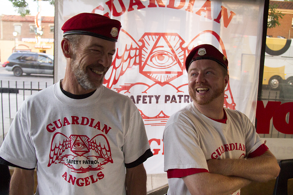 """Robi """"Wolf"""" Salo (left) and Ryan """"Archangel"""" Warren inside the Colorado Guardian Angel's most recent headquarters on Colfax Avenue, Aug. 14, 2017. (Kevin J. Beaty/Denverite)  denver; colorado; colfax; denverite; kevinjbeaty; guardian angels"""