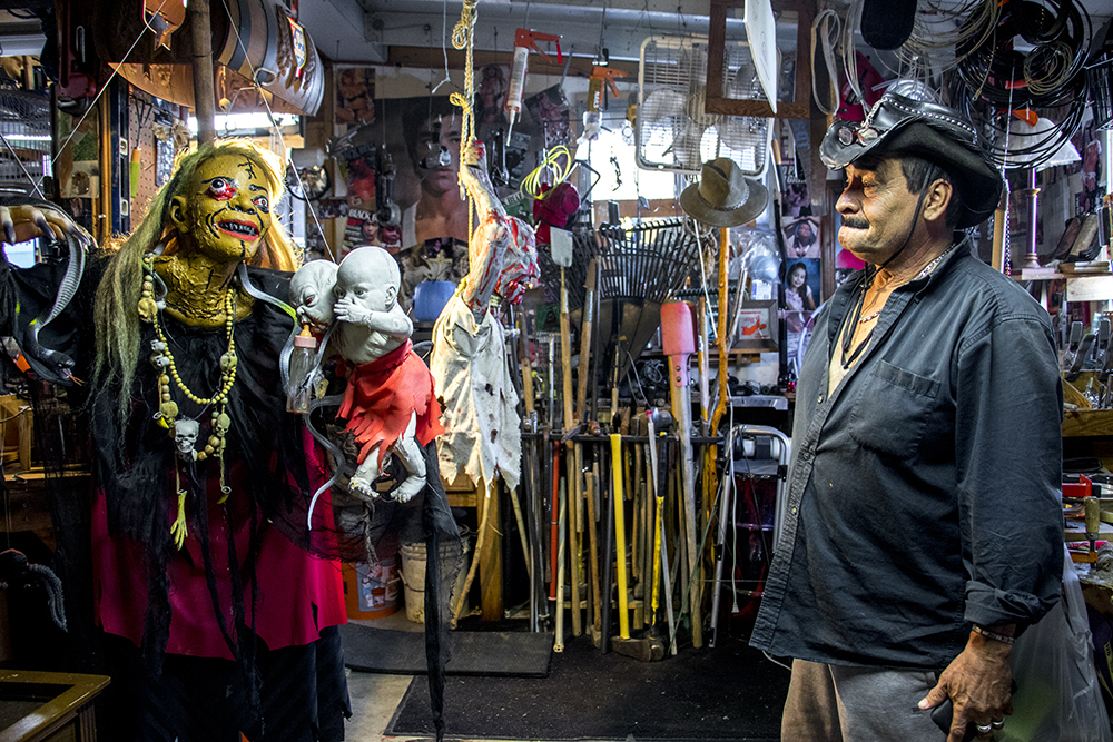 """Johnny """"the Puppetmaster"""" Sandoval (right) and """"my momma"""" in his man cave behind his Mar Lee home. Oct. 24, 2017. (Kevin J. Beaty/Denverite)  denver; colorado; denverite; kevinjbeaty; mar lee; halloween; odd spots; haunted house;"""