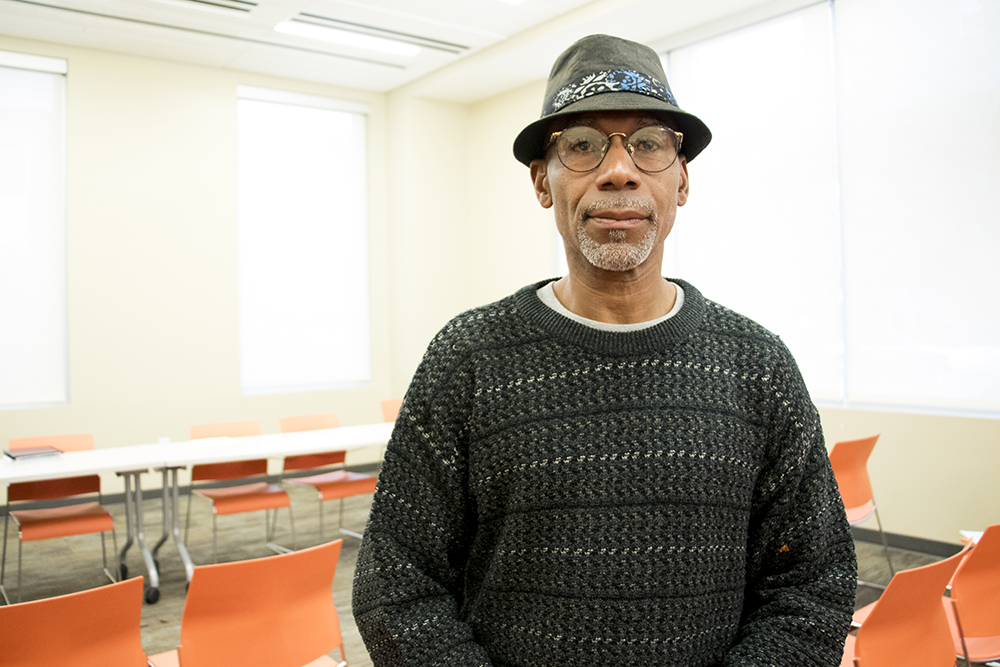 Maurice Cushinberry poses for a portriat. (Andrew Kenney/Denverite)  supportive housing; affordable housing; five points; ballpark;
