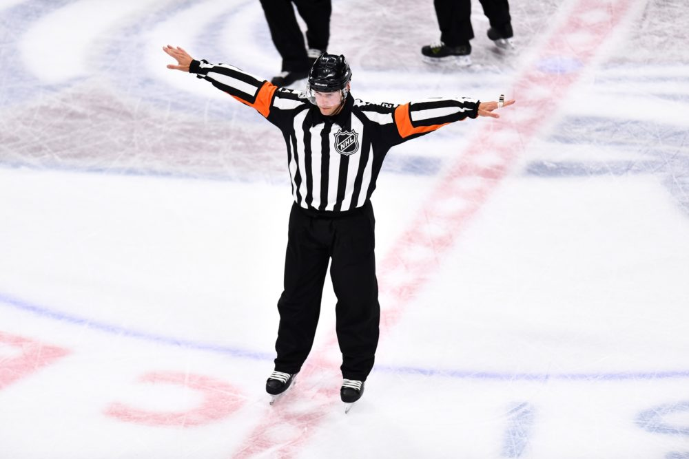 NHL referee Graham Skiliter (24) overturns a goal a Colorado Avalanche goal in the third period against the St. Louis Blues at the Pepsi Center. Oct 19, 2017; Denver, CO. (Ron Chenoy-USA TODAY Sports)