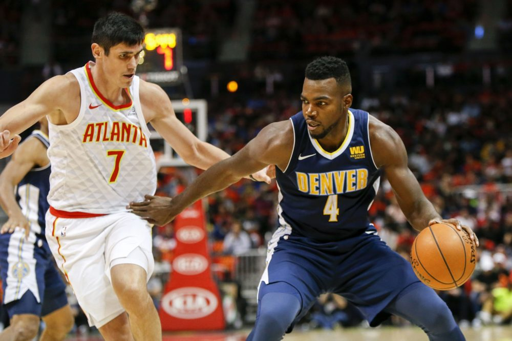 Atlanta Hawks forward Ersan Ilyasova (7) defends Denver Nuggets forward Paul Millsap (4) in the second quarter at Philips Arena. Oct 27, 2017; Atlanta, GA. (Brett Davis/USA TODAY Sports)