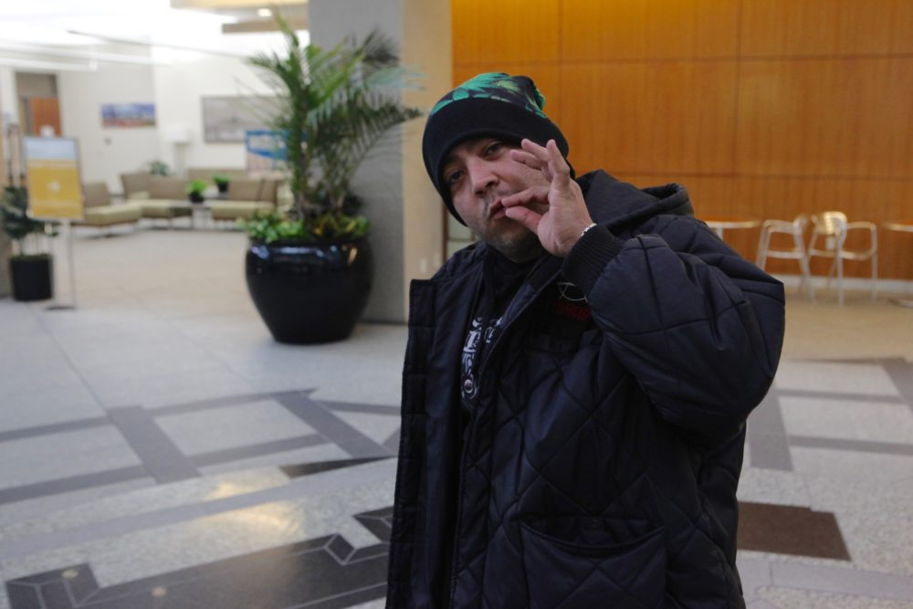 """Michael """"Smokey"""" Ortiz was not asked to pose this way. (Andrew Kenney/Denverite)"""